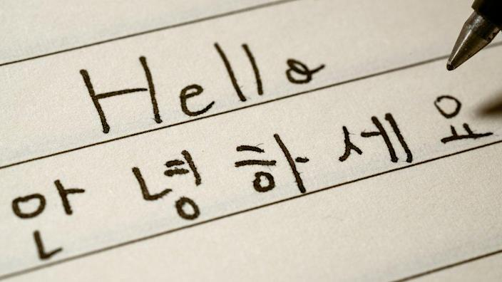 Hello and Korean words written out on piece of paper.