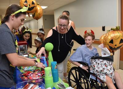 Fourteen-year-old Matthew Balogh and dozens of other pediatric patients celebrated Halloween by trick-or-treating throughout St. Joseph's Children's Hospital in Tampa on Thursday, Oct. 31, 2019.