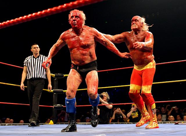 <p>Hulk Hogan throws his opponent Ric Flair to the ropes during Hulk Hogan's Hulkamania Tour at Rod Laver Arena on November 21, 2009 in Melbourne, Australia. (Photo by Mark Dadswell/Getty Images) </p>