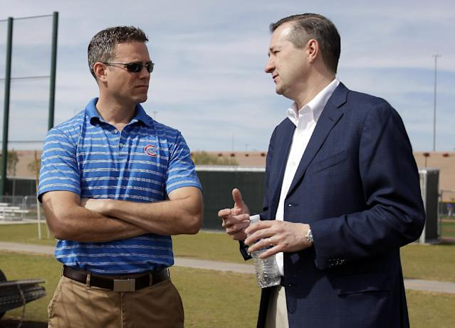 Chicago Cubs Owner Tom Ricketts, right, talks to President of Baseball Operations Theo Epstein during spring training baseball practice, Wednesday, Feb. 19, 2014, in Mesa, Ariz. (AP Photo/Rick Scuteri)