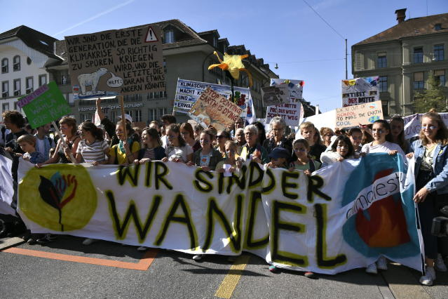 People attend a 'National Climate Strike' demonstration in Bern, Switzerland, Saturday, Sept. 28, 2019. Thousands of people, young and old, are staging a protest in the Swiss capital Bern calling for more action to curb climate change. (Anthony Anex/Keystone via AP)