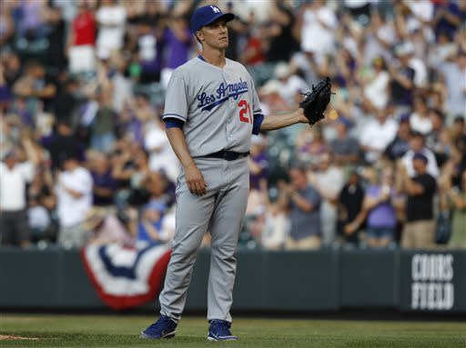 Los Angeles Dodgers starting pitcher Zack Greinke calls for a new ball after giving up a solo home run to Colorado Rockies' Carlos Gonzalez in the first inning of a baseball game in Denver, Wednesday, July 3, 2013. (AP Photo/David Zalubowski)