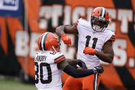 Cleveland Browns' Donovan Peoples-Jones (11) celebrates his touchdown reception with Jarvis Landry (80) during the second half of an NFL football game against the Cincinnati Bengals, Sunday, Oct. 25, 2020, in Cincinnati. (AP Photo/Michael Conroy)