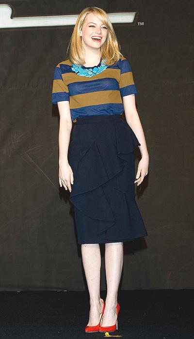 Switching out dresses for a more conservative skirt and top look, Stone still looks stylish in this Burberry Prorsum ensemble in South Korea. The blue-and-olive striped top looks great against the black skirt with the layered ruffles and the cute red pumps. But it's the aqua necklace that really stands out. (Photo by Han Myung-Gu/WireImage)