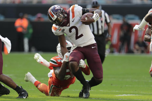 Virginia quarterback Hendon Hooker (2) runs as Miami linebacker Michael Pinckney defends during the first half of an NCAA college football game, Saturday, Oct. 5, 2019, in Miami Gardens, Fla. (AP Photo/Lynne Sladky)