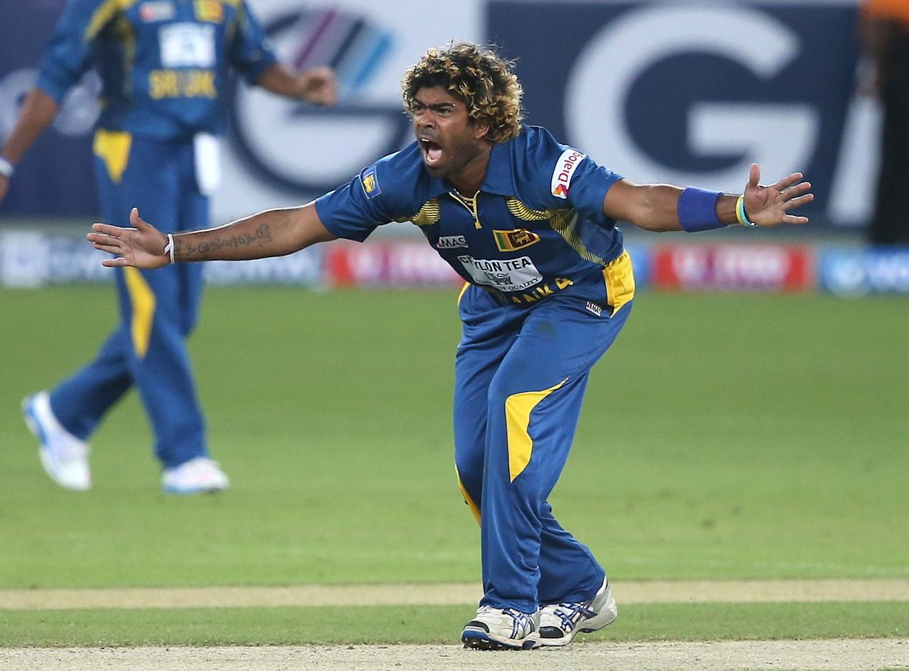 DUBAI, UNITED ARAB EMIRATES - DECEMBER 11:  Lasith Malinga of Sri Lanka apeal the wicket of Shahid Afridi of Pakistan during the first Twenty20 International match between Pakistan and Sri Lanka at Dubai Sports City Cricket Stadium on December 11, 2013 in Dubai, United Arab Emirates.  (Photo by Francois Nel/Getty Images)