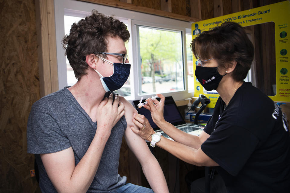 Adam Cole of Trinidad,  receives the Johnson & Johnson COVID-19 vaccine from Heidi Johnson, pediatric nurse practitioner, at Grubb's Pharmacy on Capitol Hill on Monday, April 12, 2021. (Tom Williams/CQ-Roll Call, Inc via Getty Images)