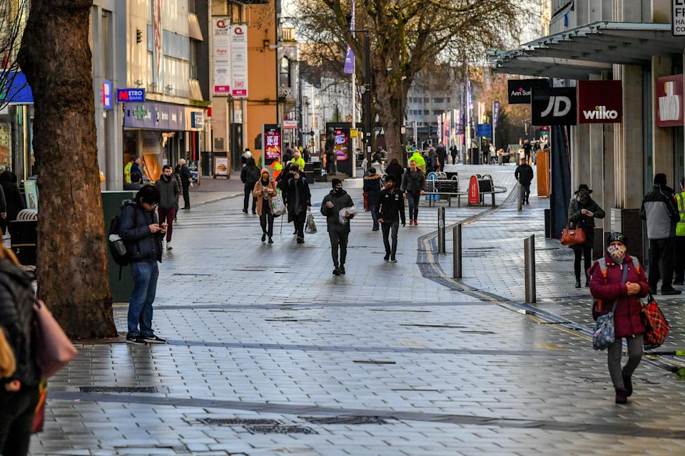 People in Cardiff city centre (PA Wire)