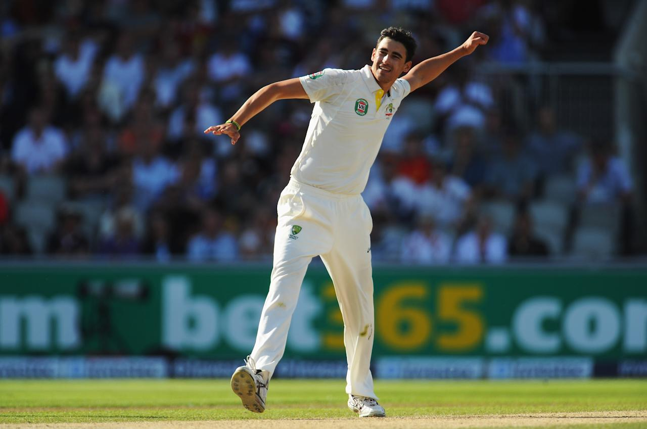 MANCHESTER, ENGLAND - AUGUST 03: Mitchell Starc of Australia celebrates the wicket of Jonny Bairstow of England during day three of the 3rd Investec Ashes Test match between England and Australia at Emirates Old Trafford Cricket Ground on August 3, 2013 in Manchester, England. (Photo by Stu Forster/Getty Images)