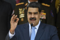 FILE - In this March 12, 2020 file photo, Venezuelan President Nicolas Maduro speaks at the Miraflores presidential palace in Caracas, Venezuela. The Trump administration pushed back Tuesday, Sept. 2, 2020 on Maduro, saying he deserves no praise for releasing a few political prisoners ahead of a congressional election when many more remain unjustly jailed. (AP Photo/Matias Delacroix, File)