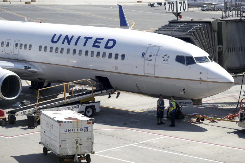 FILE - In this July 18, 2018, file photo a United Airlines commercial jet sits at a gate at Terminal C of Newark Liberty International Airport in Newark, N.J. United Continental Holdings, Inc. reports financial results Tuesday, April 16, 2019. (AP Photo/Julio Cortez, File)