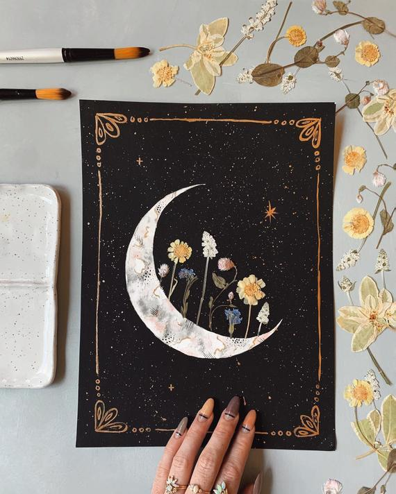 "<br><br><strong>kateshrine</strong> ""Blooming Crescent"" Embellished Print, $, available at <a href=""https://go.skimresources.com/?id=30283X879131&url=https%3A%2F%2Fwww.etsy.com%2Flisting%2F711190390%2Fembellished-print-blooming-crescent"" rel=""nofollow noopener"" target=""_blank"" data-ylk=""slk:Etsy"" class=""link rapid-noclick-resp"">Etsy</a>"