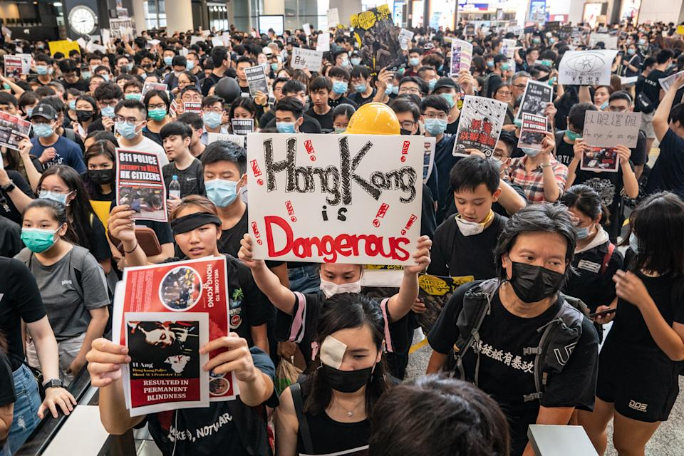 Protesters occupy the arrival hall of the Hong Kong International Airport during a demonstration on August 12, 2019 in Hong Kong, China. Photo: Anthony Kwan/Getty Images