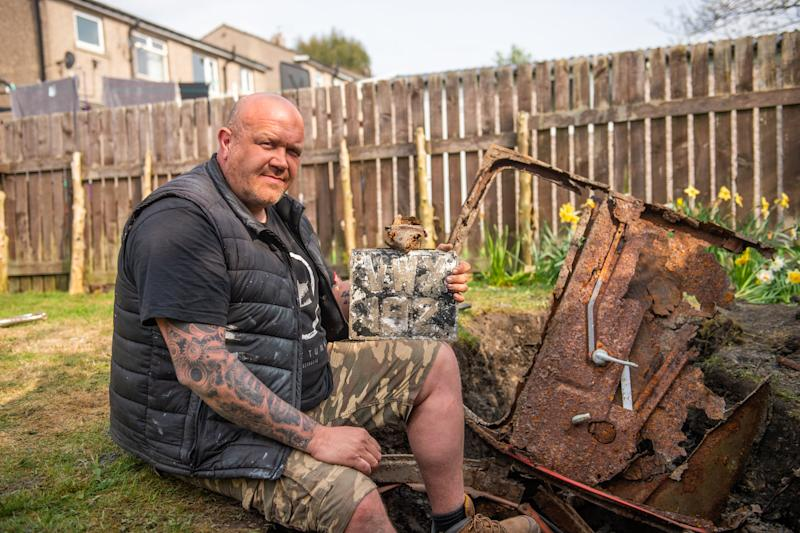 John Brayshaw was doing some gardening during lockdown when he unearthed a 1950s Ford in his back garden. (Picture: SWNS)