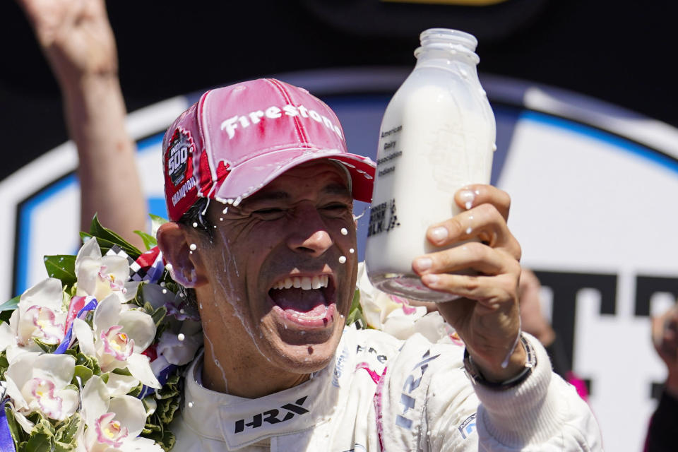 Helio Castroneves, of Brazil, celebrates after winning the Indianapolis 500 auto race at Indianapolis Motor Speedway in Indianapolis, Sunday, May 30, 2021. (AP Photo/Michael Conroy)