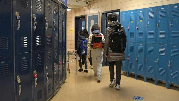 PHOTO: Students file into their classroom at Sun Yat Sen M.S. 131, Feb. 25, 2021, in New York. (Michael Loccisano/Getty Images)