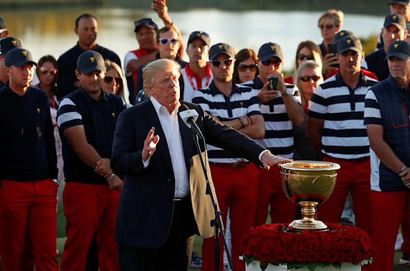 President Donald Trump did dedicate the Presidents Cup golf trophy to hurricane victims on Oct. 1, 2017. (Kevin Lamarque / Reuters)