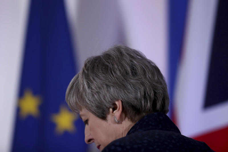 British Prime Minister Theresa May leaves after addressing a media conference at an EU summit in Brussels, Friday, March 22, 2019. Worn down by three years of indecision in London, EU leaders on Thursday were grudgingly leaning toward giving the U.K. more time to ease itself out of the bloc. (AP Photo/Francisco Seco)
