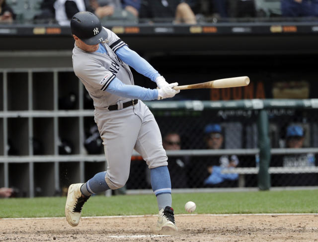New York Yankees' Clint Frazier grounds out softly by Chicago White Sox third baseman Jose Rondon during the eighth inning of a baseball game in Chicago, Sunday, June 16, 2019. The Yankees won 10-3. (AP Photo/Nam Y. Huh)