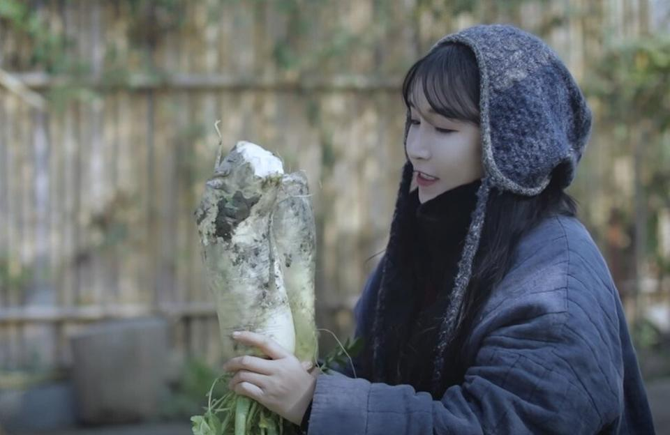 Li Ziqi, a Chinese internet celebrity, in a still from a video showing her pickling Chinese cabbage, radish and sausages using a method similar to that used for kimchi. Photo: YouTube/Li Ziqi