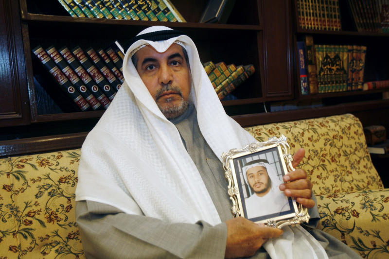 Khalid al-Odah, father of Fawzi al-Odah, holds a picture of his son at his home in the Qurtuba district of Kuwait City on January 8, 2012 (AFP Photo/Yasser al-Zayyat)