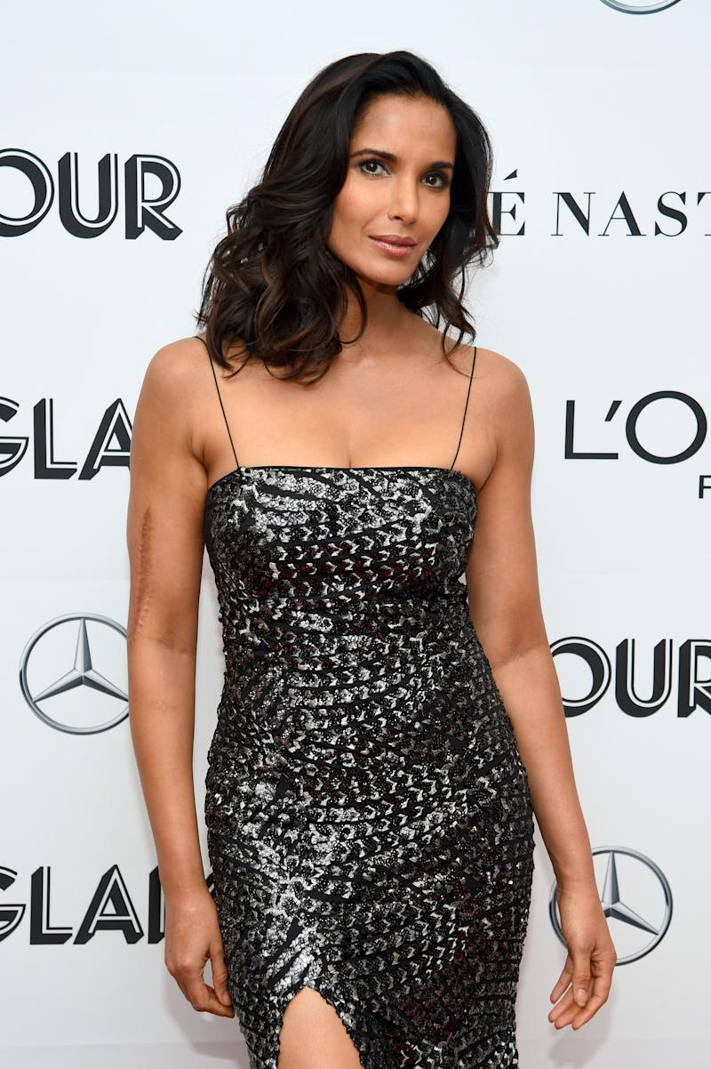 Padma Lakshmi stuns in a black shiny dress that shows off her curves on the red carpet