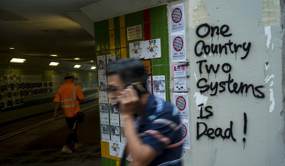 """Grafitti in Hong Kong, where anti-government protests have hardened Taiwan's attitude to the """"one country, two systems"""" framework for reunification with the mainland. Photo: Warton Li"""