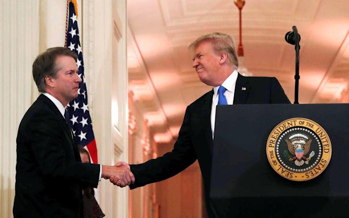 President Donald Trump introduces his Supreme Court nominee Judge Brett Kavanaugh, left, in the East Room of the White House on July 9, 2018. (Photo: Leah Millis/AP)