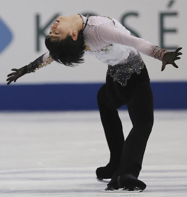 Yuzuru Hanyu of Japan performs during the men's free skating in the World Figure Skating Championships in Saitama, near Tokyo, Friday, March 28, 2014. Hanyu barely topped the free skate to become the first man in 12 years on Friday to win the Olympic and world figure skating titles in the same year. (AP Photo/Koji Sasahara)