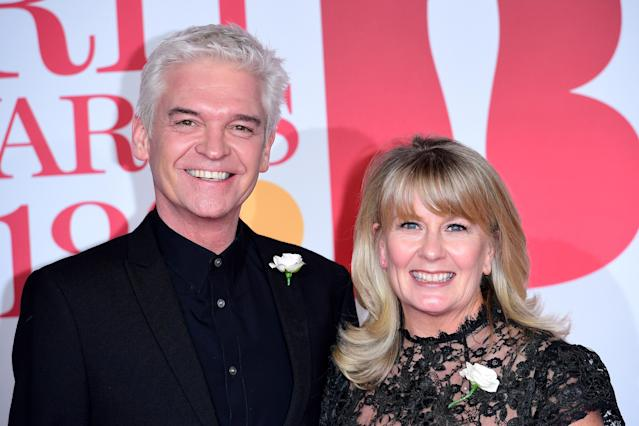 Phillip Schofield and wife Stephanie Lowe attending the Brit Awards in 2019 (Getty)