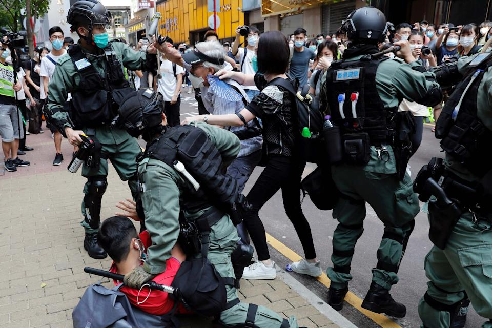 Anti-government demonstrators scuffle with riot police during a lunch time protest in Hong Kong, China, on May 27, 2020: REUTERS