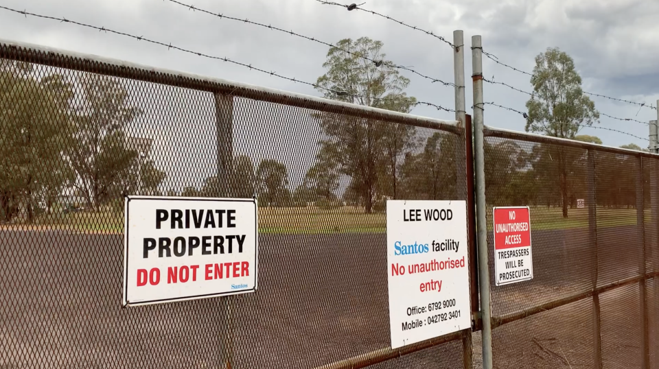 A private property sign on the gates of Santos' Leewood water treatment facility.