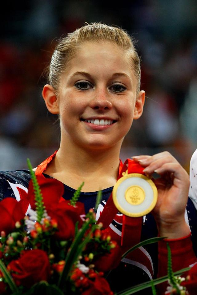 Gold medalist Shawn Johnson of the USA poses on the podium during the medal ceremony for the Women's Beam Final at the National Indoor Stadium on Day 11 of the Beijing 2008 Olympic Games on August 19, 2008 in Beijing, China.