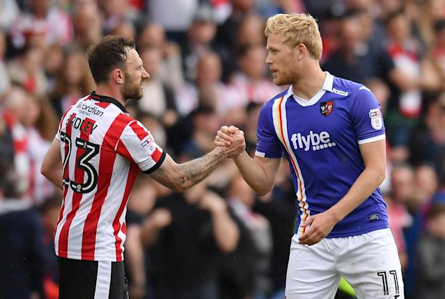 "Soccer Football - League Two Play Off Semi Final First Leg - Lincoln City v Exeter City - Sincil Bank, Lincoln, Britain - May 12, 2018 Lincoln City's Neal Eardley shakes the hand of Exeter City's Jayden Stockley at full time Action Images/Paul Burrows EDITORIAL USE ONLY. No use with unauthorized audio, video, data, fixture lists, club/league logos or ""live"" services. Online in-match use limited to 75 images, no video emulation. No use in betting, games or single club/league/player publications. Please contact your account representative for further details."