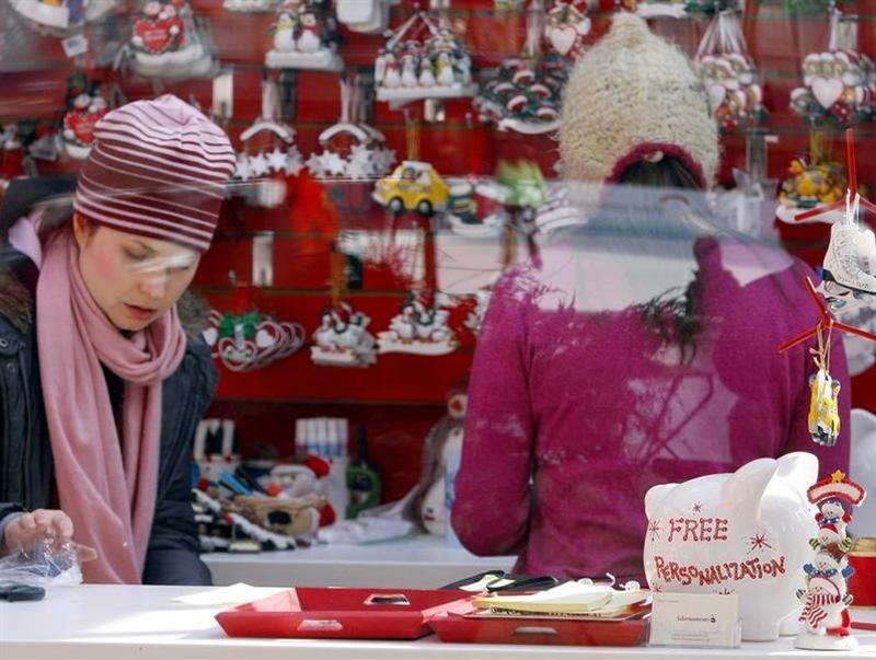 A free personalization promotion is seen inside a holiday-themed store in New York's