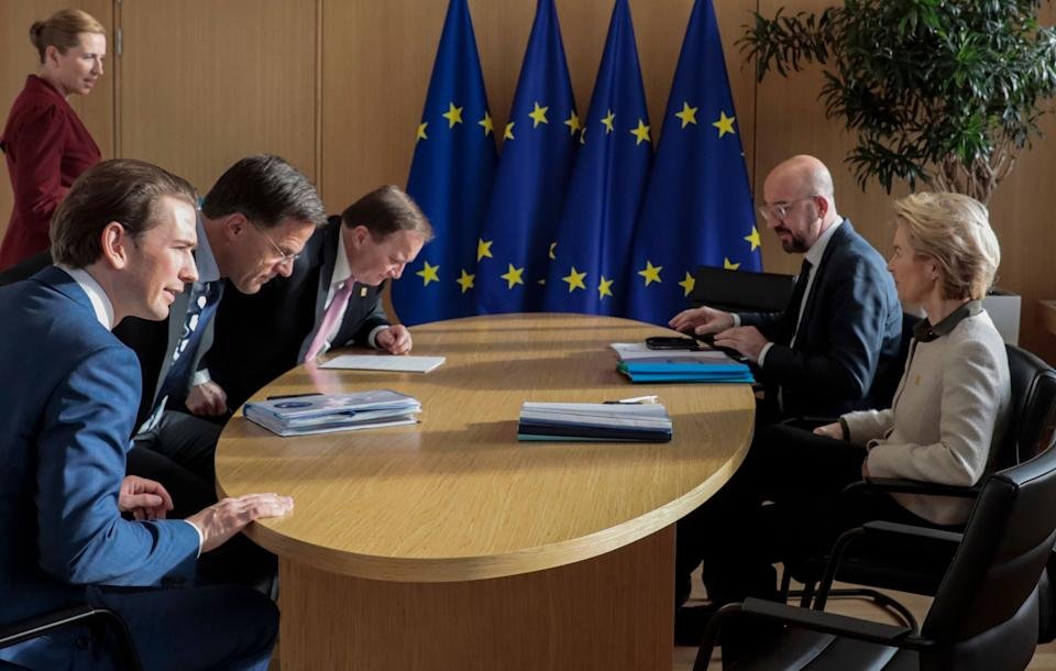 """Heads of self-styled """"frugal"""" nations (LtoR) Austria's Chancellor Sebastian Kurz, Netherlands' Prime Minister Mark Rutte, Sweden's Prime Minister Stefan Lofven, Denmark's Prime Minister Mette Frederiksen (up L), President of the European Council Charles Michel and President of the European Commission Ursula von der Leyen meet on the sidelines of a special European Council summit in Brussels on February 20, 2020, held to discuss the next long-term budget of the European Union (EU). (Photo by Virginia Mayo / POOL / AFP) (Photo by VIRGINIA MAYO/POOL/AFP via Getty Images) (Photo: VIRGINIA MAYO via Getty Images)"""