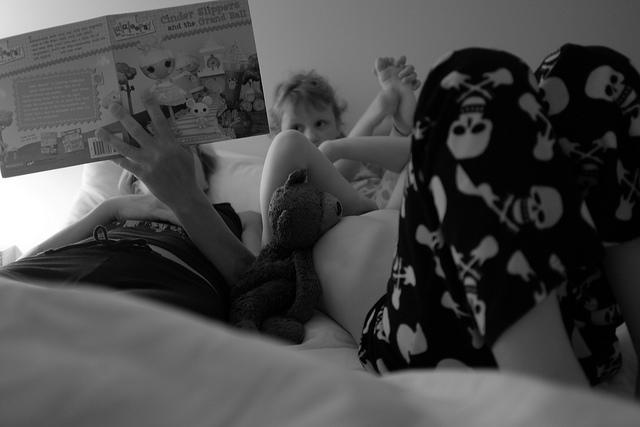 """<div class=""""caption-credit""""> Photo by: Flickr</div><div class=""""caption-title"""">Read a bedtime story together</div>I have five kids, so sometimes reading to everyone separately can feel like a game of musical books (and let's face it: it takes forever.) The solution: shared reading time with a book everyone can get into. Worried about finding a book everyone will like? Don't be afraid to try meatier material. I still remember listening to my mother read The Hobbit out loud when I was about 4 years old. I didn't understand it all, but I liked spending the time with my big brothers."""