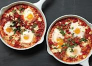 """A superior protein and flavor-packed way to start the day. <a href=""""https://www.bonappetit.com/recipe/poached-eggs-in-tomato-sauce-with-chickpeas-and-feta?mbid=synd_yahoo_rss"""" rel=""""nofollow noopener"""" target=""""_blank"""" data-ylk=""""slk:See recipe."""" class=""""link rapid-noclick-resp"""">See recipe.</a>"""