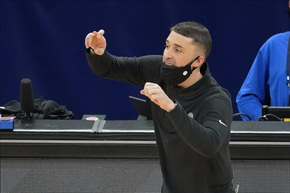 Minnesota Timberwolves coach Ryan Saunders gestures to players during the second half of the team's NBA basketball game against the Toronto Raptors, Friday, Feb. 19, 2021, in Minneapolis. (AP Photo/Jim Mone)