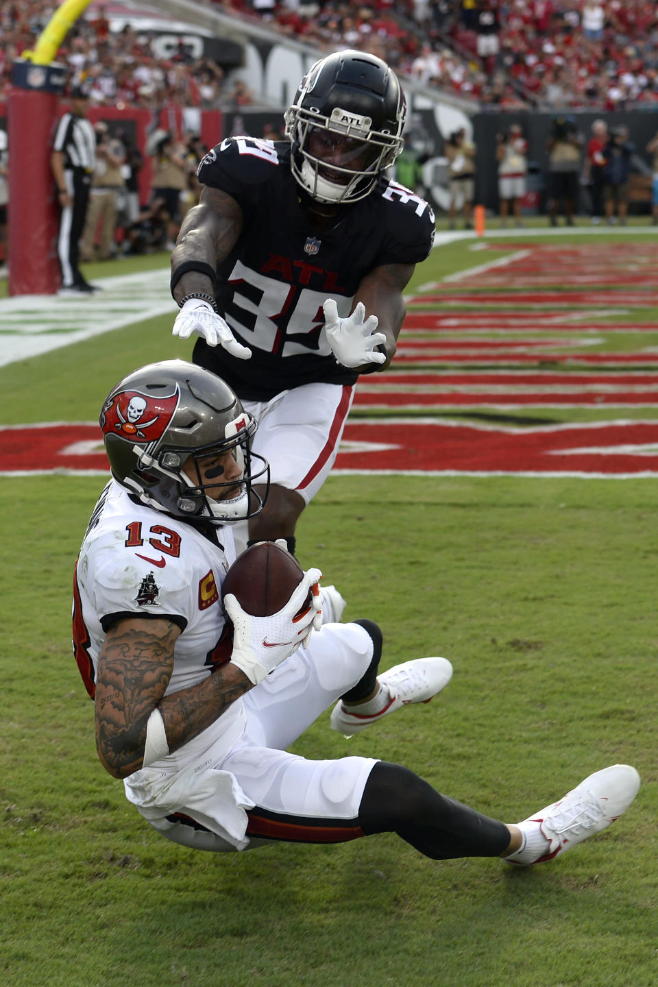 **CORRECTS ATLANTA DEFENDER TO T.J. GREEN**Tampa Bay Buccaneers wide receiver Mike Evans (13) beats Atlanta Falcons defensive back T.J. Green (39) on a 1-yard touchdown reception during the second half of an NFL football game Sunday, Sept. 19, 2021, in Tampa, Fla. (AP Photo/Jason Behnken)