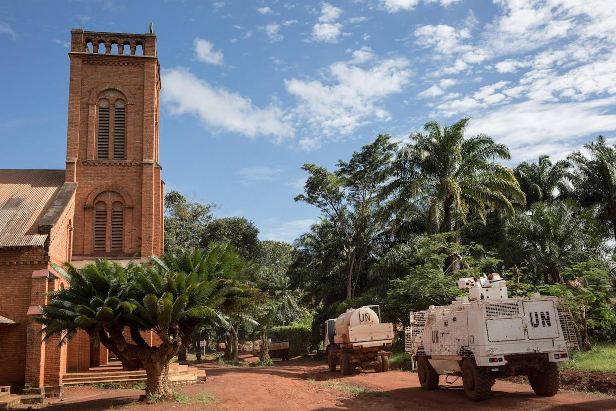 MINUSCA's armored vehicles and tankers operate next to the cathedral of Bangassou in southeastern Central African Republic on Aug. 22, 2017. (Photo: Alexis Huguet/AFP/Getty Images)