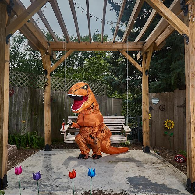 <p>Realtor Bambi Chase dressed as the comedic T. rex for the home's showcase shots. (Photo: Nebraska Realty/Caters News) </p>