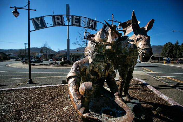 A bearded prospector panning for gold and his pack mule greet visitors to Yreka.