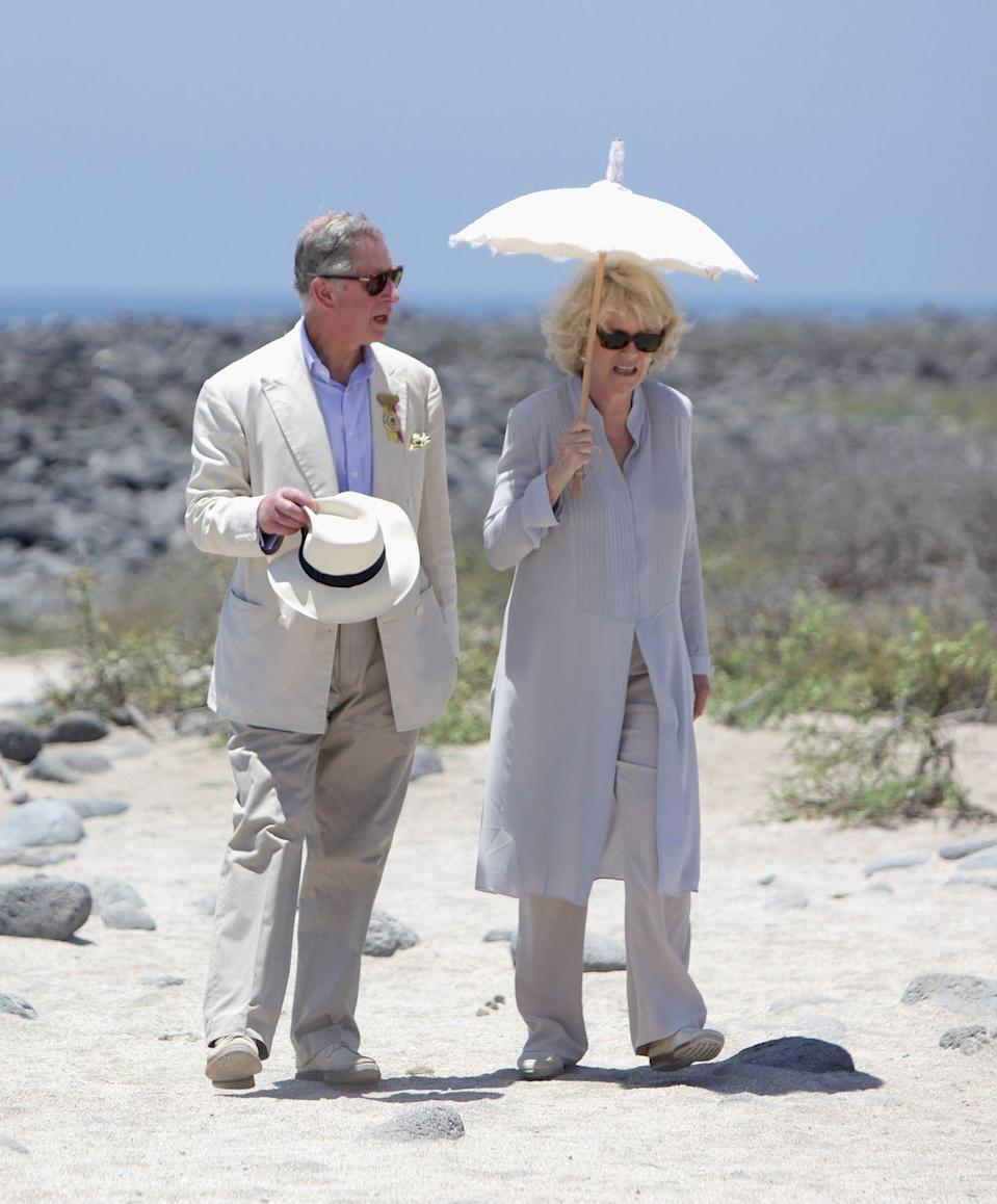 <p>Prince Charles and Camilla, Duchess of Cornwall stayed shaded while walking along the beach on North Seymour Island in the Galapagos. The couple dressed in coordinating colors and materials, keeping (as) cool (as possible) in loose, breezy fabrics.<br></p>