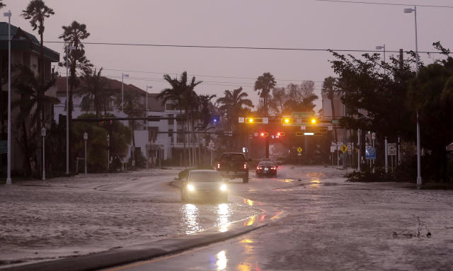 <p><strong>Naples</strong><br> Vehicles drive through a flooded street as Hurricane Irma passes through Naples, Fla., Sept. 10, 2017. (Photo: David Goldman/AP) </p>
