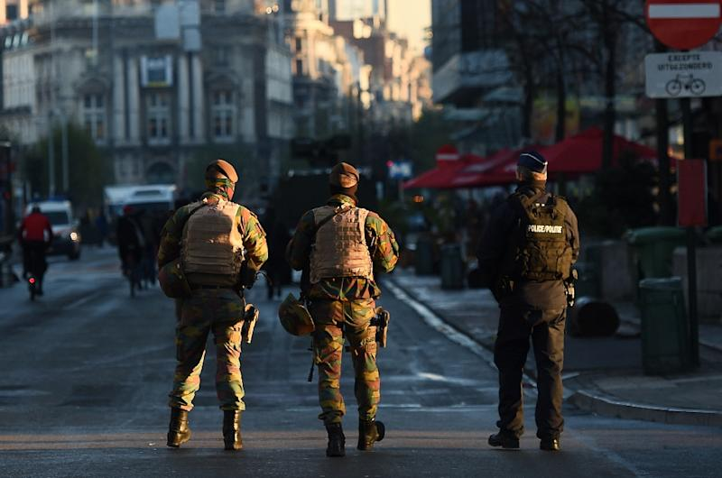 Belgian soldiers and police patrol Brussels following a raid in connection with the Paris attacks that left 130 people dead (AFP Photo/Emmanuel Dunand)