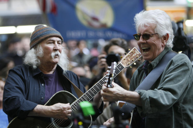 """FILE - In this Nov. 8, 2011 file photo, singers David Crosby, left,  and Graham Nash perform at the Occupy Wall Street encampment at Zuccotti Park in New York.  Music is woven into the fabric of Occupy Wall Street, much like when civil rights protesters sang """"We Shall Overcome"""" or 1960s demonstrators heard """"Blowin' in the Wind"""" or """"Give Peace a Chance."""" Crosby and Nash's manager sent an email to Occupy Wall Street's website asking if the musicians could perform. (AP Photo/Mary Altaffer, file)"""