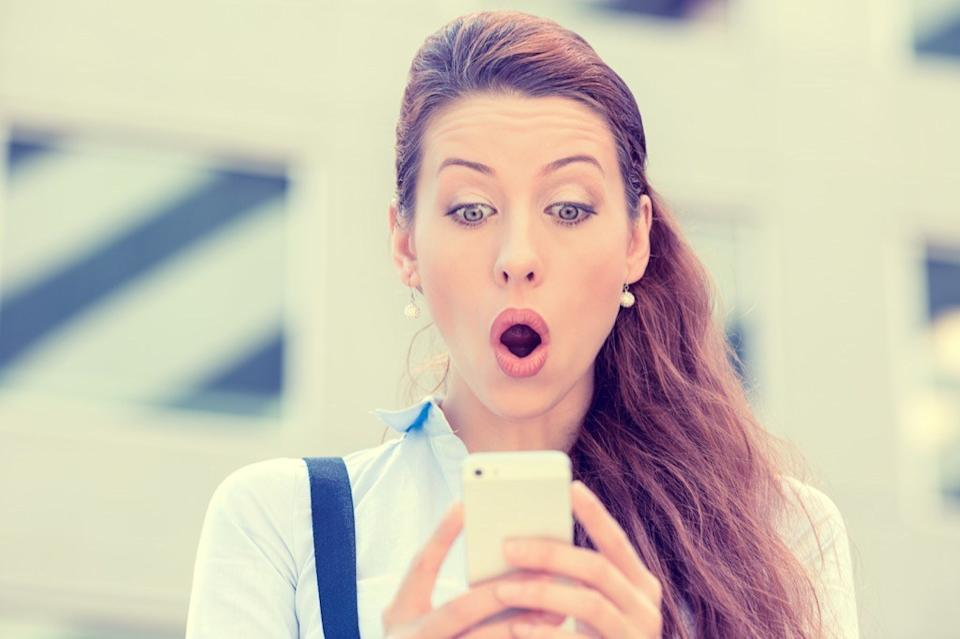 woman looking surprised at phone commonly misused phrases