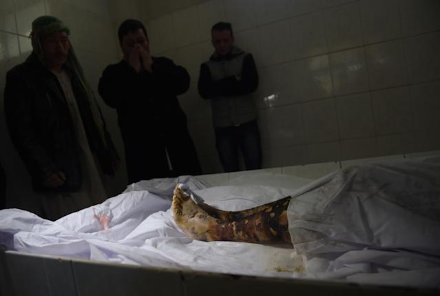 "<p>Afghan relatives react as they stand near the body of Saeed Jawad Hossini, 29, who was killed in a suicide attack on a minibus carrying employees of Afghan TV channel TOLO in Kabul on January 21, 2016. Seven employees of popular Afghan TV channel TOLO were killed on January 21 when a Taliban car bomber rammed into their minibus in Kabul, just months after the militants declared the network a legitimate ""military target"". (Photo: Shah Marai/ AFP/Getty Images) </p>"