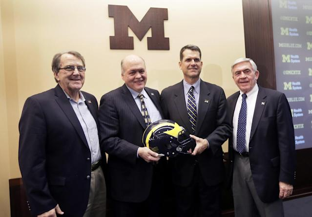 Former Michigan coach Lloyd Carr (far left) stepped down from the College Football Playoff selection committee for health reasons. (AP Photo/Carlos Osorio)